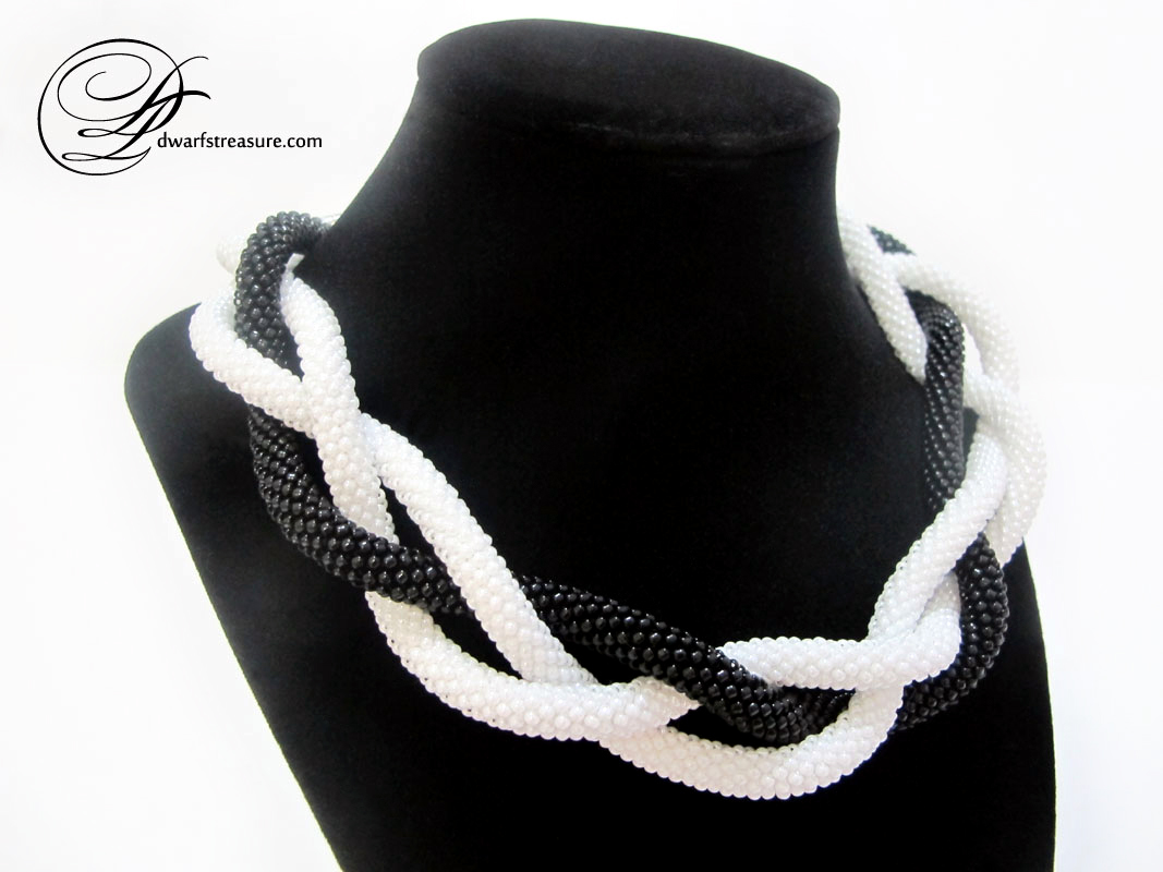 amazing collection of black and white beaded lariats