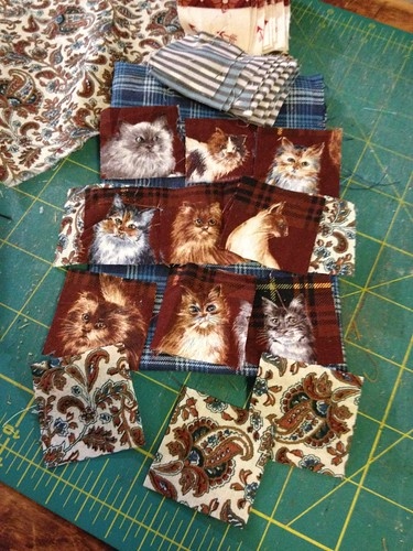 Another row of kitties in the Scrappy Bargello
