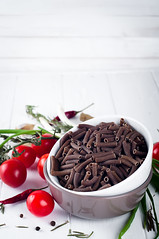 Italian food background with pene, vine tomatoes,…