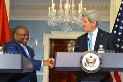 U.S. Secretary of State John Kerry shakes hands with Angolan Foreign Minister Georges Chikoti after they addressed reporters at the U.S. Department of State in Washington, D.C., on December 17, 2014. [State Department photo/ Public Domain]