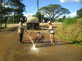 Getting washed down after a more than muddy adventure.  San Ignacio, Belize.