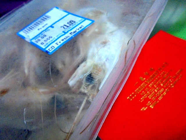 Frozen packs of prawns