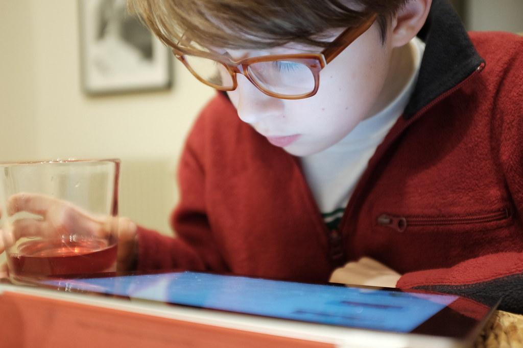 M, using iPad
