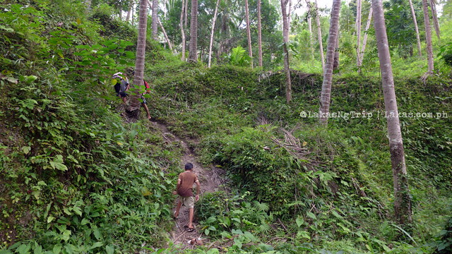 Going back up the steep trail to Kalubihon Falls in Iligan City, Philippines