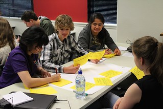 Students writing down user stories as part of the BA and UX work. Photo by Kristina Hoeppner