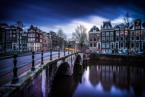 street longexposure bridge blue houses sunset sky holland netherlands colors dutch amsterdam clouds reflections lights movement bikes keizersgracht