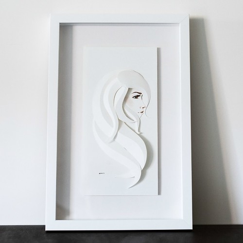 paper sculpture of woman's profile in frame