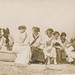 Small photo of Group of women posing on a small boat on the sand