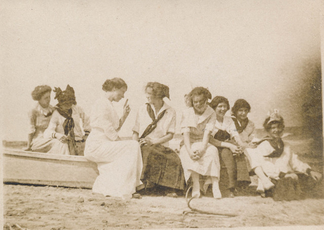 Group of women posing on a small boat on the sand from Flickr via Wylio
