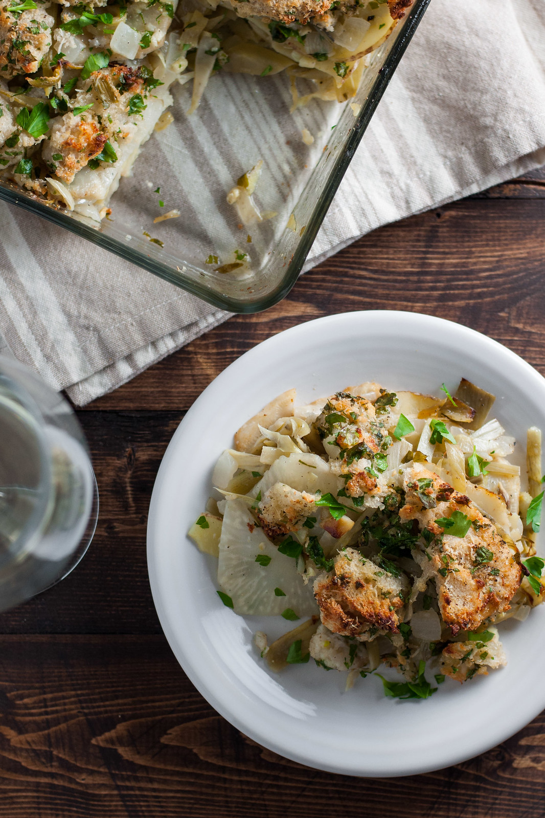 Artichoke, celery root, and potato gratin with crispy garlic bread topping