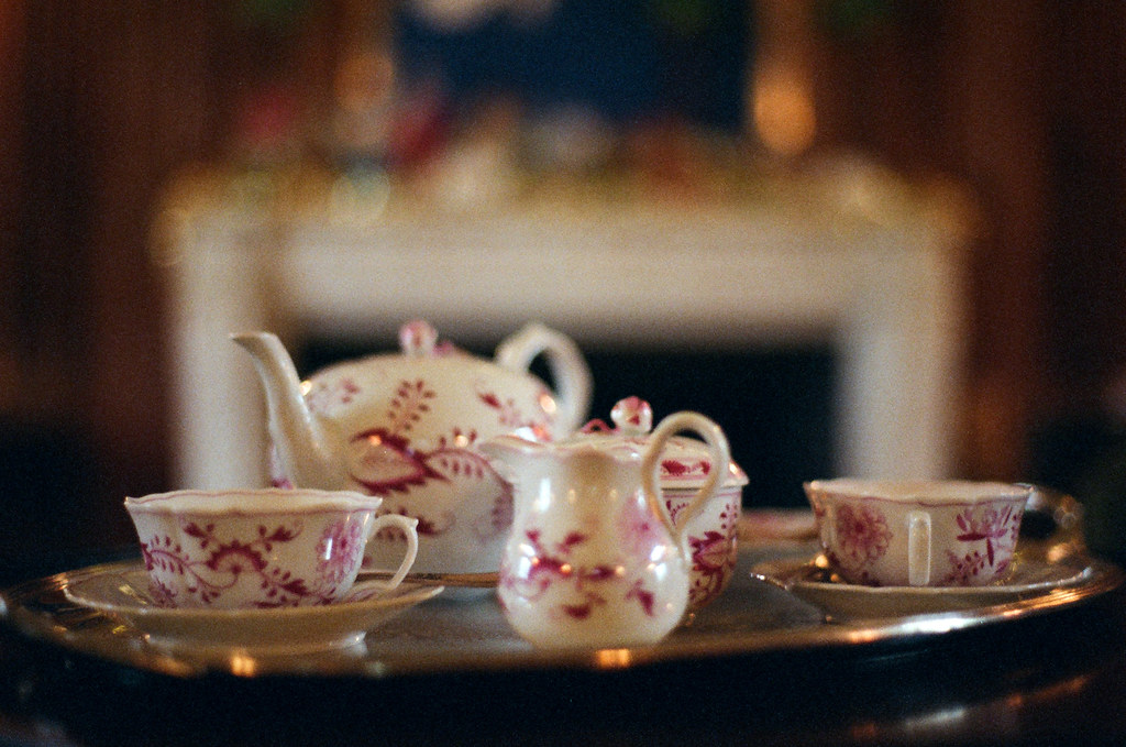 Tea service before the fireplace