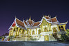 A night shot of Buddhist Society Hall next to That Luang complex