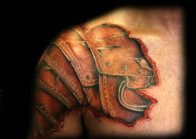 Armor chest plate tattoo roman by ray tutty explore for Chest plate tattoos