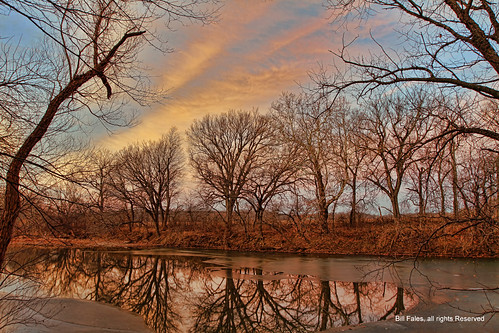 trees sunset sky color reflection ice nature water weather clouds sunrise river season landscape outdoors kansas cpimages