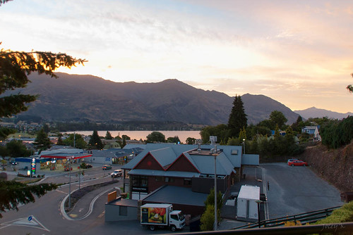 road street sunset newzealand sky lake cars architecture clouds buildings town village southisland centralotago wanaka mountians lakewanaka tripdownsouth