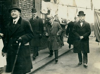Neville Chamberlain surveying Newcastle's slums