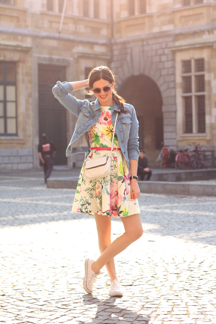 girly spring outfit: floral Closet London dress, white Converse, denim jacket