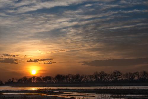 sunset sun silhouette clouds river evening nebraska cottonwood prairie plains magichour greatplains goldenlight platteriver prairieriver plainscottonwood