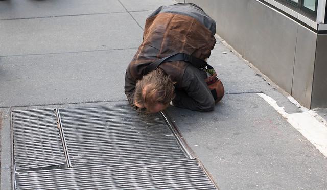 Seeking truth from under a sidewalk grate