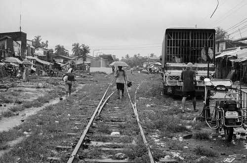 life street city railroad bw wet umbrella 35mm photography walk philippines human rainy sur activity region bicol irigacity camarines iriga