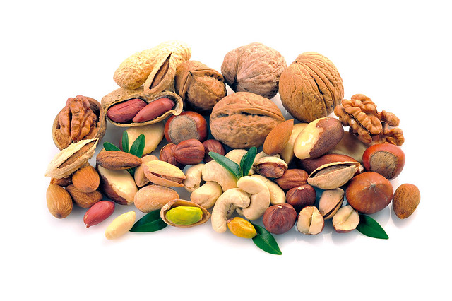 Peanuts, cashews, pistachio, almonds, walnuts, Brazil nuts and hazelnuts on a white background