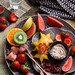 Fruits platter serves with dried plum powder by Ira Rodrigues