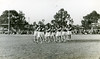 'Back to Kurri Kurri' festival marching girls at the football ground, Kurri Kurri, NSW, 1954