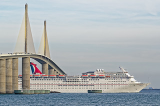 Carnival Paradise's smokestack is under the Sunshine Skyway Bridge, St. Petersburg, Florida