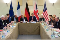 U.S. Secretary of State John Kerry, U.S. Energy Secretary Dr. Ernest Moniz, and other advisers meet with German Foreign Minister Frank-Walter Steinmeier, European Union Deputy Secretary General Helga Schmid, and French Foreign Minister Laurent Fabius on March 28, 2015, in Lausanne, Switzerland, before the P5+1 members resume negotiations with Iranian leaders about the future of their nuclear program. [State Department Photo / Public Domain]