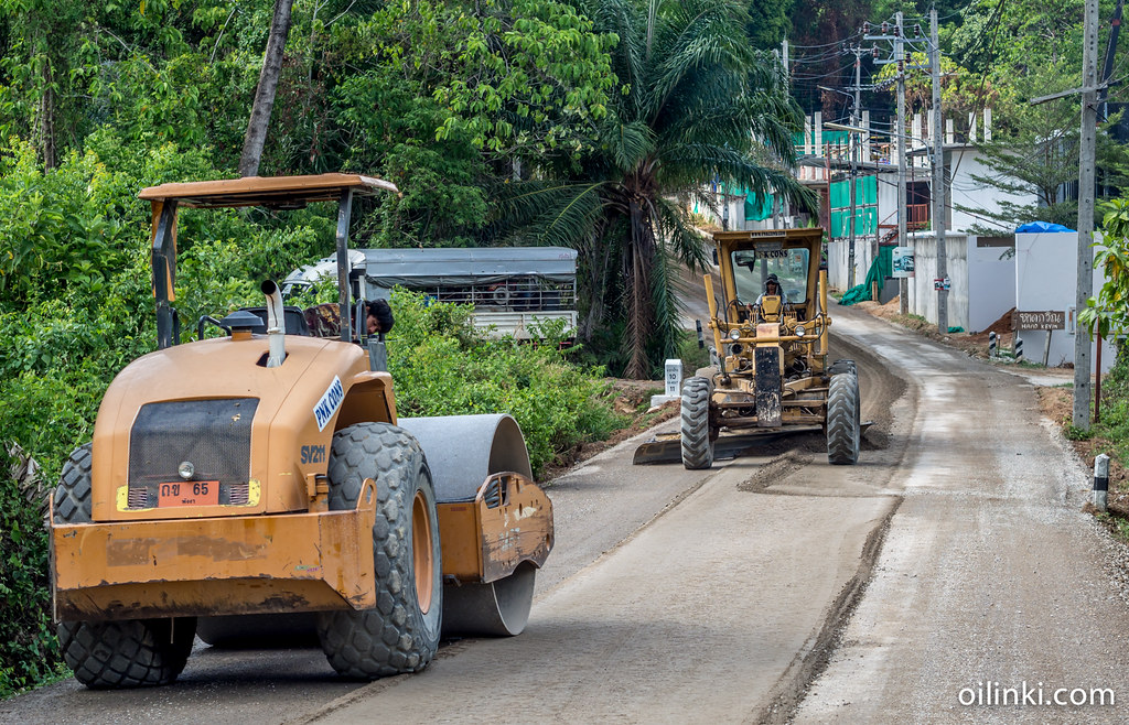 Packing and pressing sand to create a new road