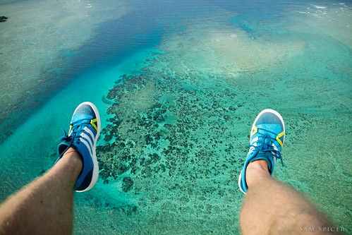 ocean above trip blue sea summer vacation holiday seascape water beautiful coral japan fun flying asia paradise view legs para turquoise vibrant kagoshima lagoon aerial adventure clear tropical hanging colourful paragliding gliding reef idyllic parachute amami oshima