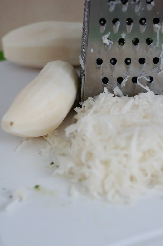 Grating the daikon to make pickled daikon radish by Eve Fox, The Garden of Eating, copyright 2015