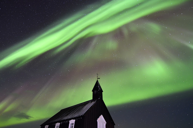 Northern Lights over Black church at Budir, Iceland