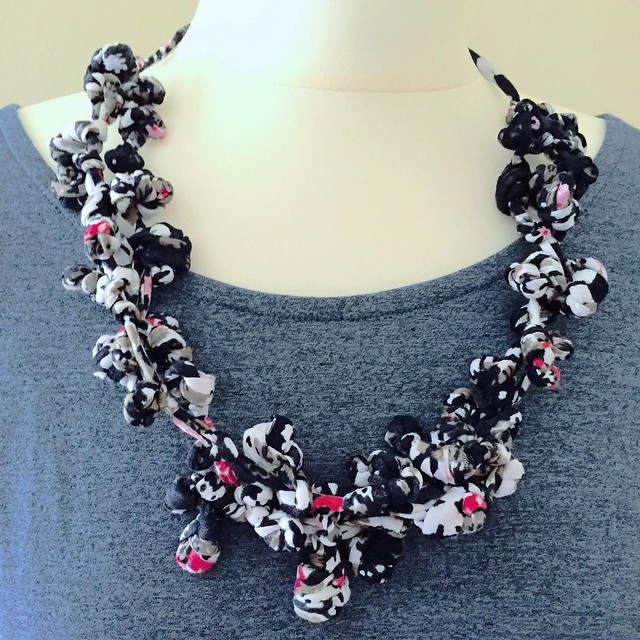 Knotted statement necklace.