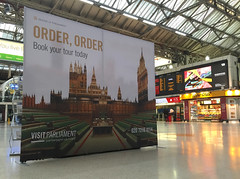 Visit Parliament campaign backdrop at Victoria Station
