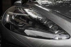 wheel(0.0), rim(0.0), bumper(0.0), automobile(1.0), automotive exterior(1.0), vehicle(1.0), automotive lighting(1.0), automotive design(1.0), light(1.0), headlamp(1.0), land vehicle(1.0), luxury vehicle(1.0),
