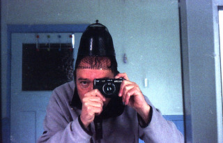 reflected self-portrait with Halina 35-600 camera and mourning hat