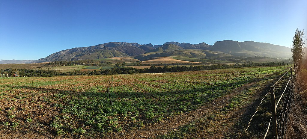 panoramic farmlands and mountainscape