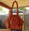 Namaste Zuma bag in Saddle.