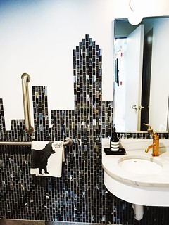 mosaic glass tile skyline (city of charlotte) in a commercial space public restroom, by lakbdesign/home with heart