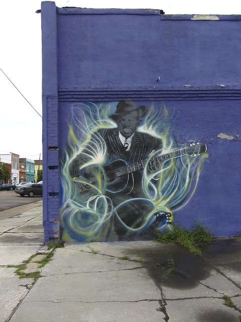 robert johnson playing blues in the flames of hell, clarksdale, ms