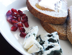 Blue cheese, pomegranate seeds, bread and honey