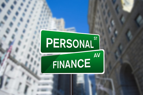 Personal Finance Street Sign On Wall Street