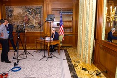 U.S. Secretary of State John Kerry reviews his notes on March 27, 2015, before recording video remarks for a meeting of U.S. Chiefs of Mission gathered in Washington, D.C., while he participated in Iranian nuclear negotiations in Lausanne, Switzerland. [State Department Photo / Public Domain]