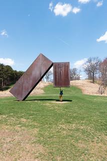 Gonçalo Holds Up Sculpture