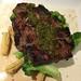 N.Y. STRIP STEAK steamed broccoli, baby corn & green curry chimichurri