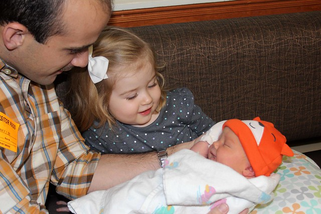 Harper holding Finnegan for the first time