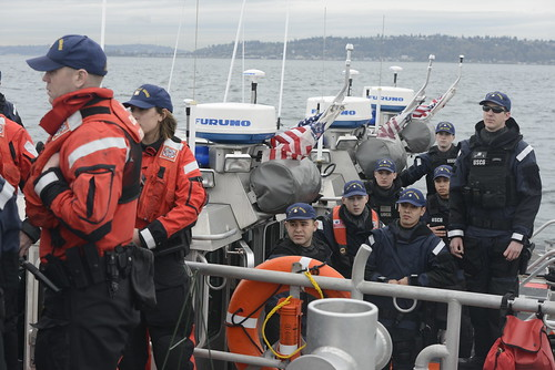 Members of Coast Guard Maritime Safety and Security Team 91101 in Seattle participate in an at-sea wreath laying ceremony in honor of Petty Officer 3rd Class Ronald Gill Jr. near Vashon Island, Wash., March 25, 2015. Gill died in the line of duty in 2007, after being being ejected from one of the 25-foot Defender-class boats while deployed to MSST Seattle. (U.S. Coast Guard photo by Petty Officer 3rd Class Amanda Norcross)