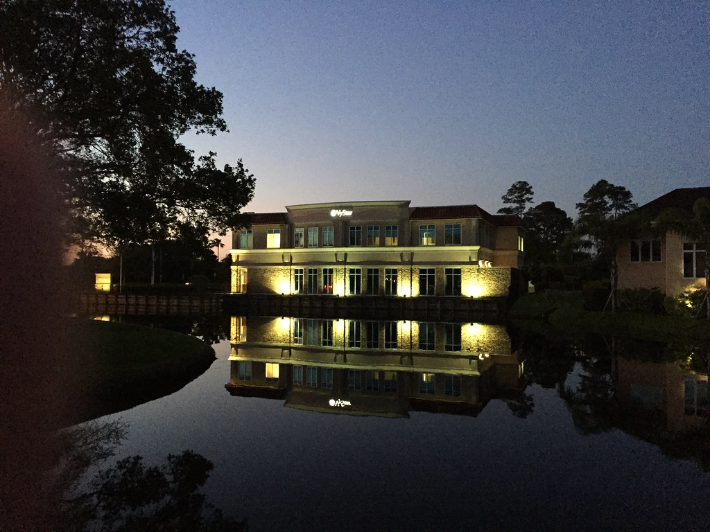 Picture of a building reflected in a pond taken before dawn on an iPhone 6