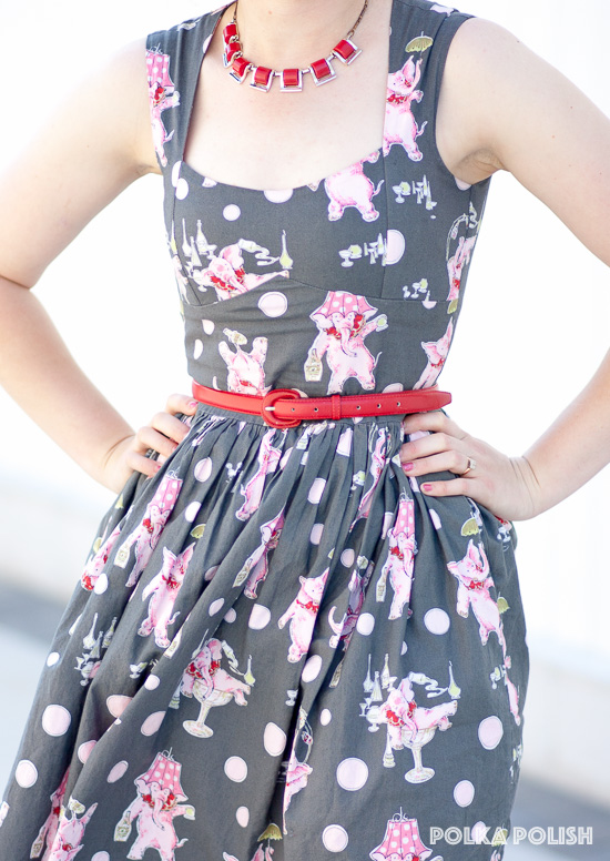 A red belt and necklace bring out the red accents in this Bernie Dexter drunken pink elephants novelty print dress